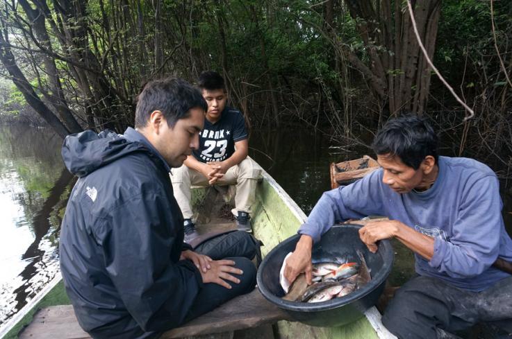 "Jorge ""Coco"" Alarcon interviews a fisherman in Peru"