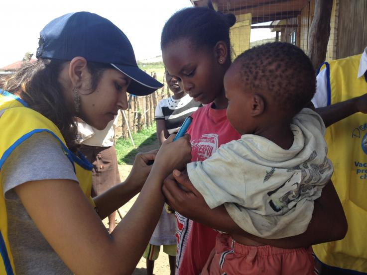 A resident provides a polio test in Kenya
