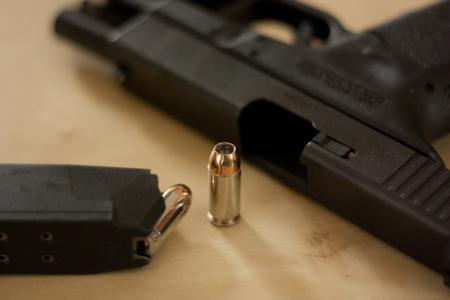 Photo of a handgun and bullets